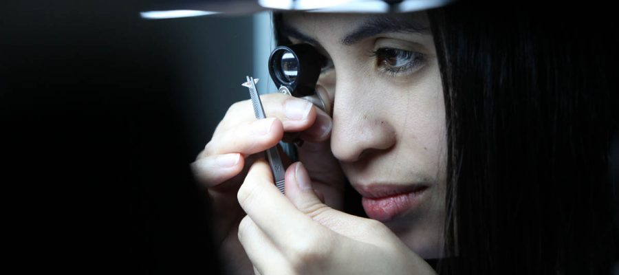 DUBAI, UNITED ARAB EMIRATES - FEBRUARY 8:  Anabel Hosena, a diamond grader, checks over a diamond at the International Gemological Institute (IGI), a scientific laboratory for the identification and grading of diamonds, coloured stones and fine jewellery, in the Almas Tower in the Jumeirah Lakes Towers, Dubai, on February 8, 2011.  (Randi Sokoloff for The National)  For Business story by Armina Ligaya